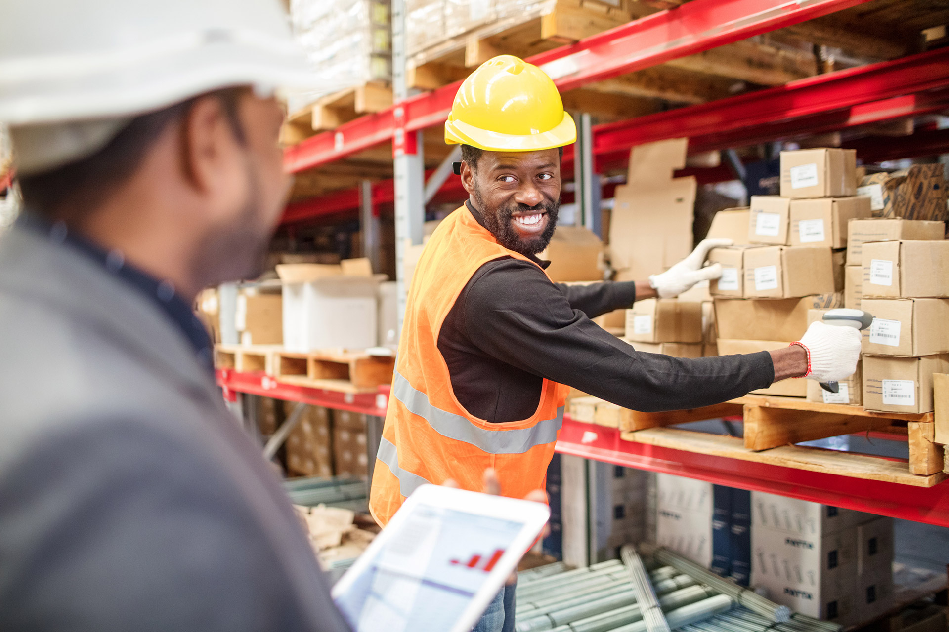 Man being observed in warehouse by training supervisor